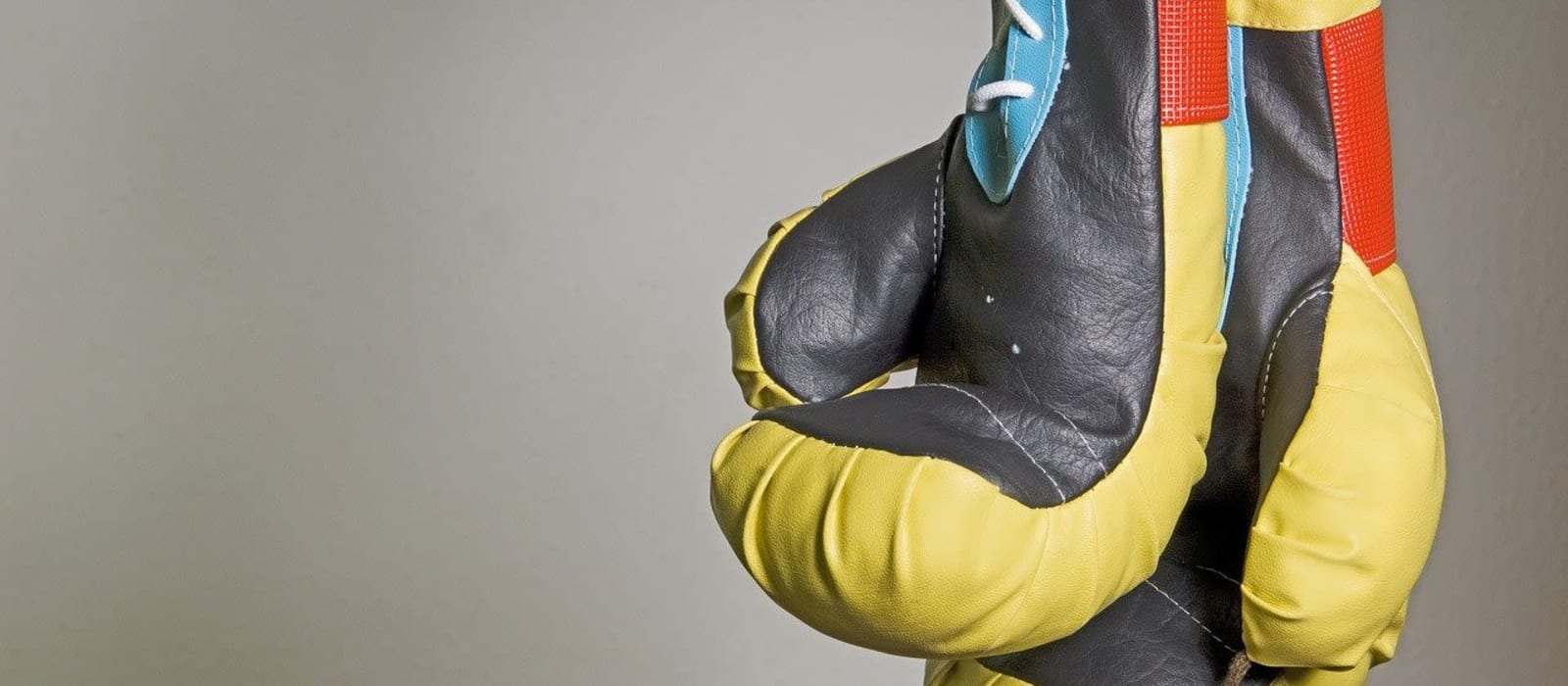 Image shows two yellow and red boxing gloves