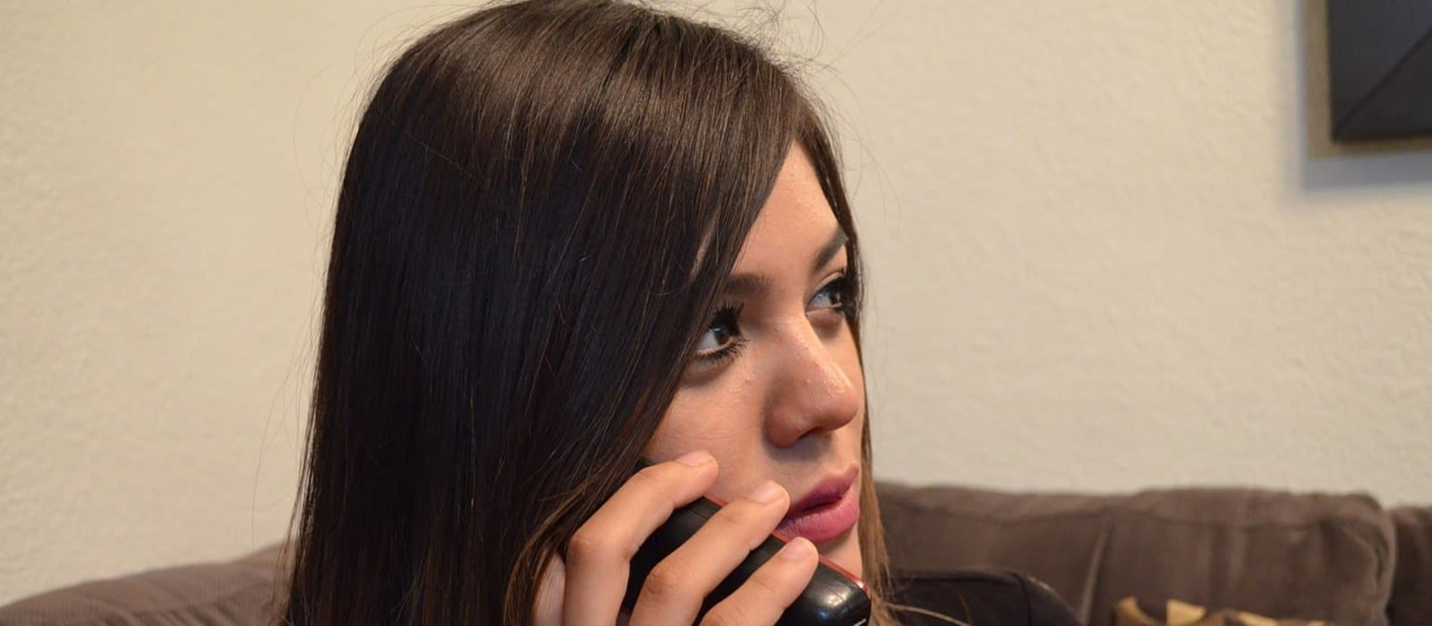 Image of a woman on the phone