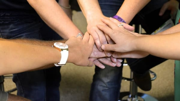 Image of hands to portray teamwork