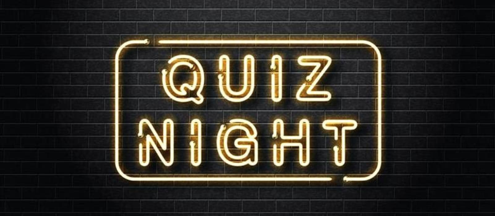Black and gold sign which reads Quiz Night.